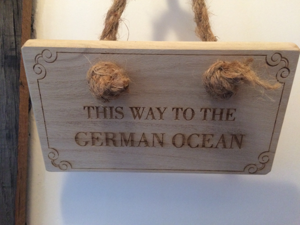 Staithes folk call the North Sea 'the German Ocean'. Sign made by author for a Staithes property. Copyright John Keeling
